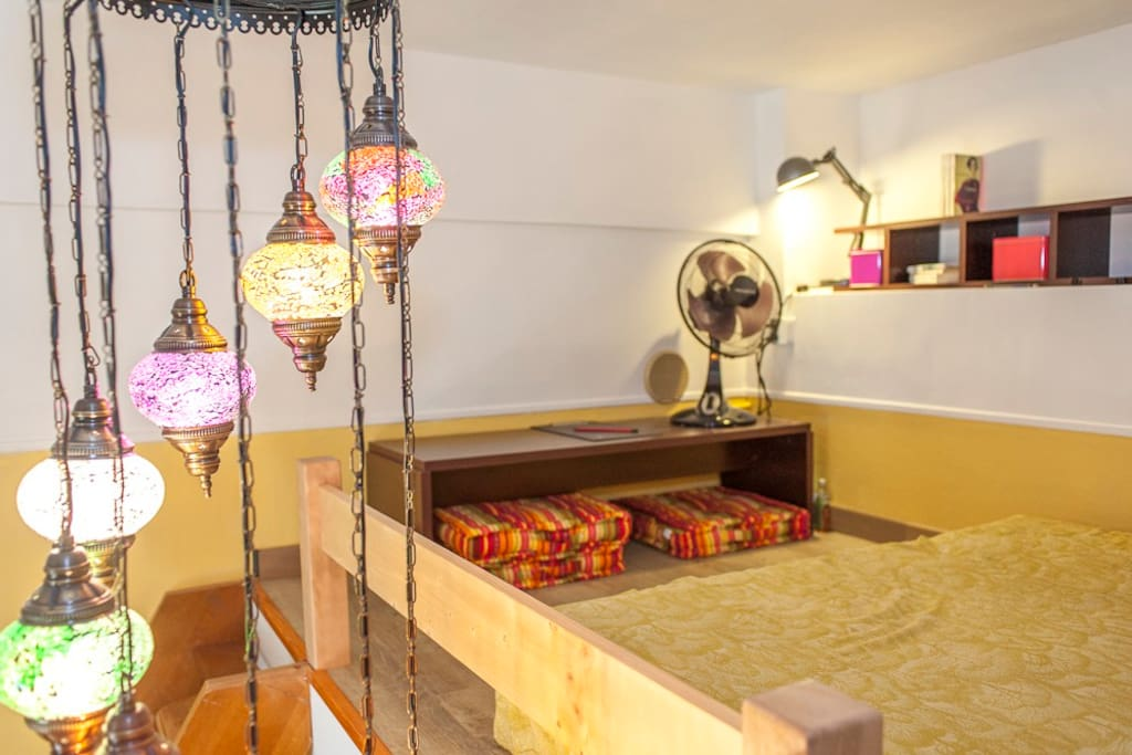 The mezzanine with your comfy sleeping area, in a colourful atmosphere