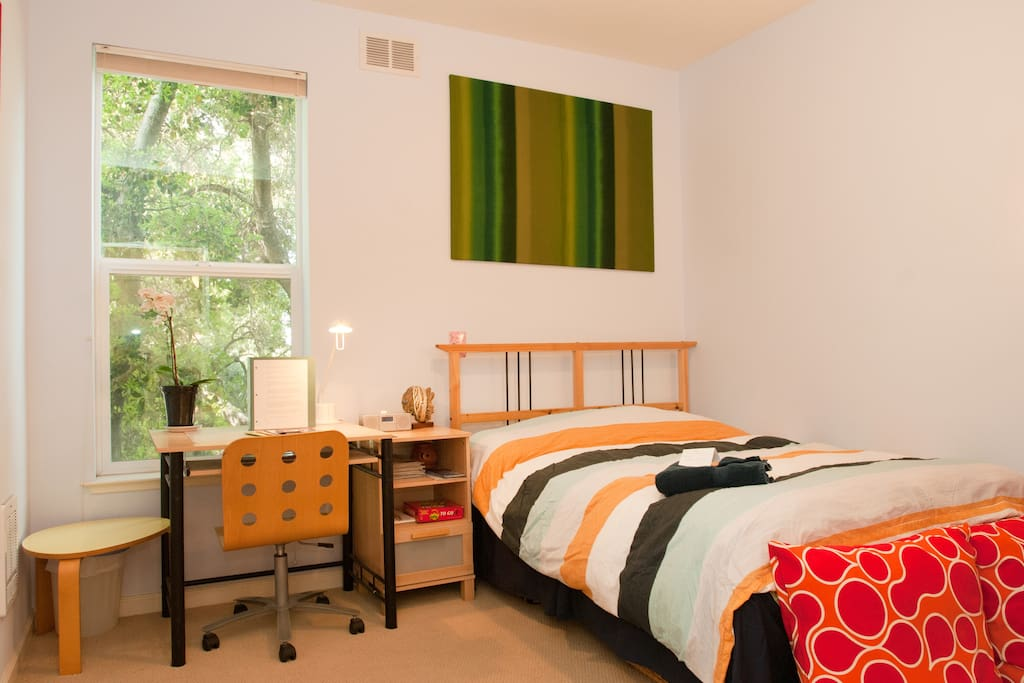 Private bedroom with ample closet space and study area that is adjacent to private bathroom for your use only.