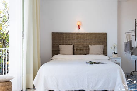 Amazing room with painted floor and private terrace with orange and lemon trees.