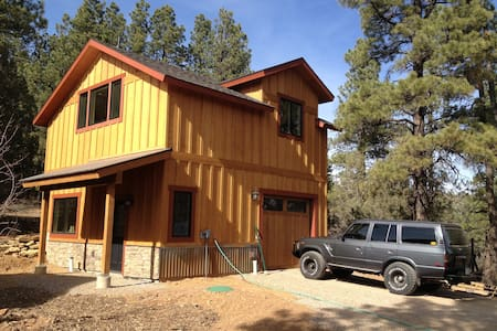 This spacious studio nestled amongst Ponderosa pines is a quiet, tranquil getaway. You'll never know you are just 10 minutes from all that Downtown Durango has to offer. Sleeps two in a new queen bed and has a full bath, full kitchen, washer & dryer.