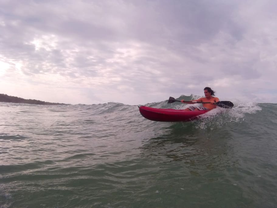 Kayak Surfing in front of the cabin!!