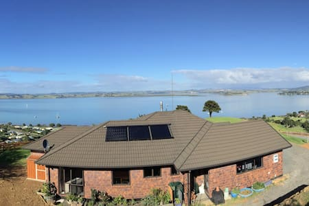 Two bed rooms available one double bed with own bathroom. One with twin singles. Rooms are small & cosy.  Access to entire house in shared areas. Self catering breakfast & meals. Summer holiday rates will apply from the first day of  Summer December 1st $35 NZD per person per night.