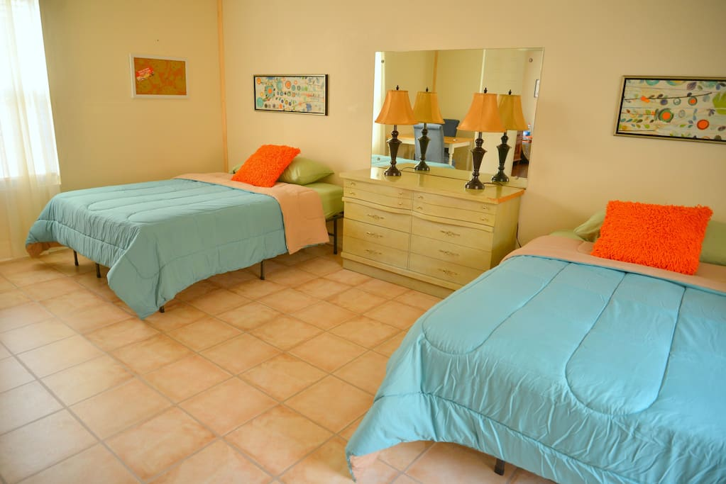 Huge sleeping room with 2 full sized beds dresser, lamps, table, 2 chairs and 2 twin cots. One side can be cleared for yoga, dance, etc...