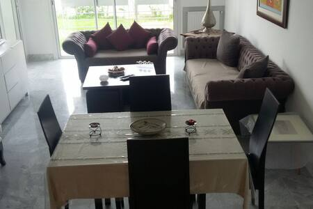 Luxueux appart neuf ac grand jardin - Flat