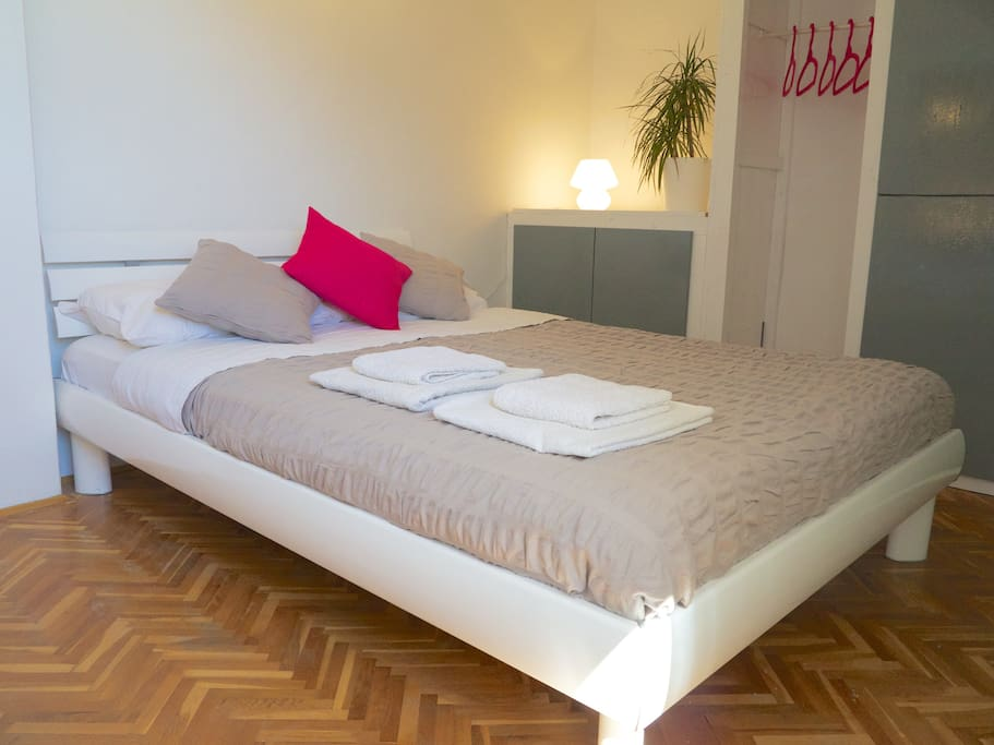 Air-conditioned bedroom with double bed, storage and wonderful view of the old town and hill behind Hvar