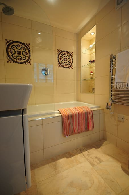 An en-suite with bath and shower