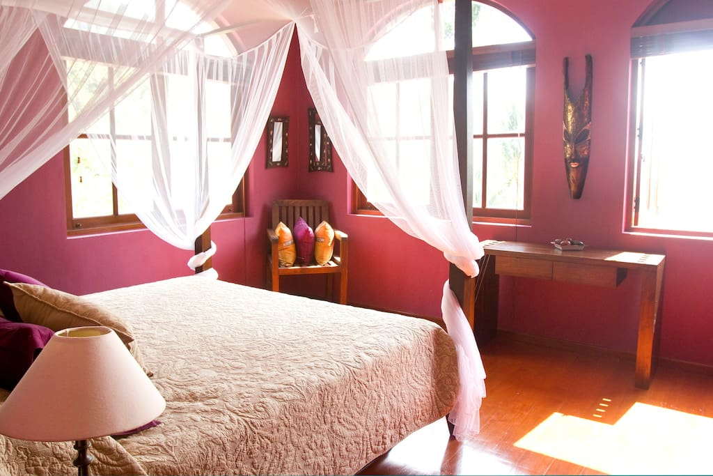 Cambridge Master Bedroom with AC, fan and views of the sea, pool and garden - on top level of main house