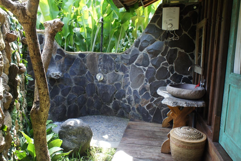 Half outdoor bathroom with a rain shower - enjoy bathing in the nature!
