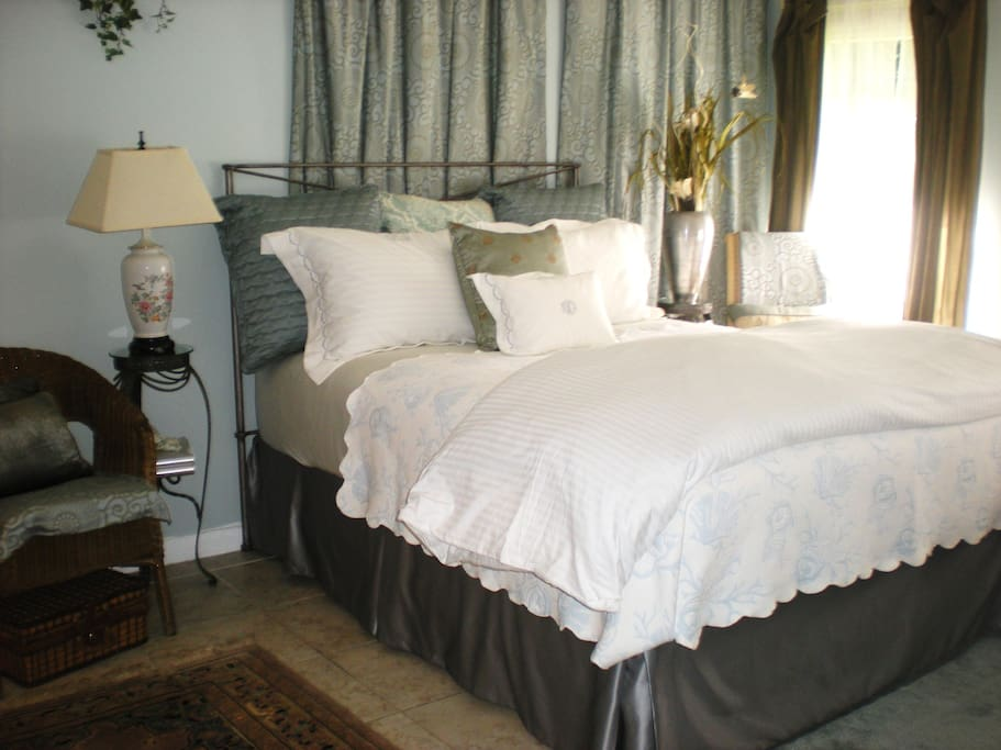 Your private, new queen size bed, Hotel Collection sheets, steps to your private full bath.