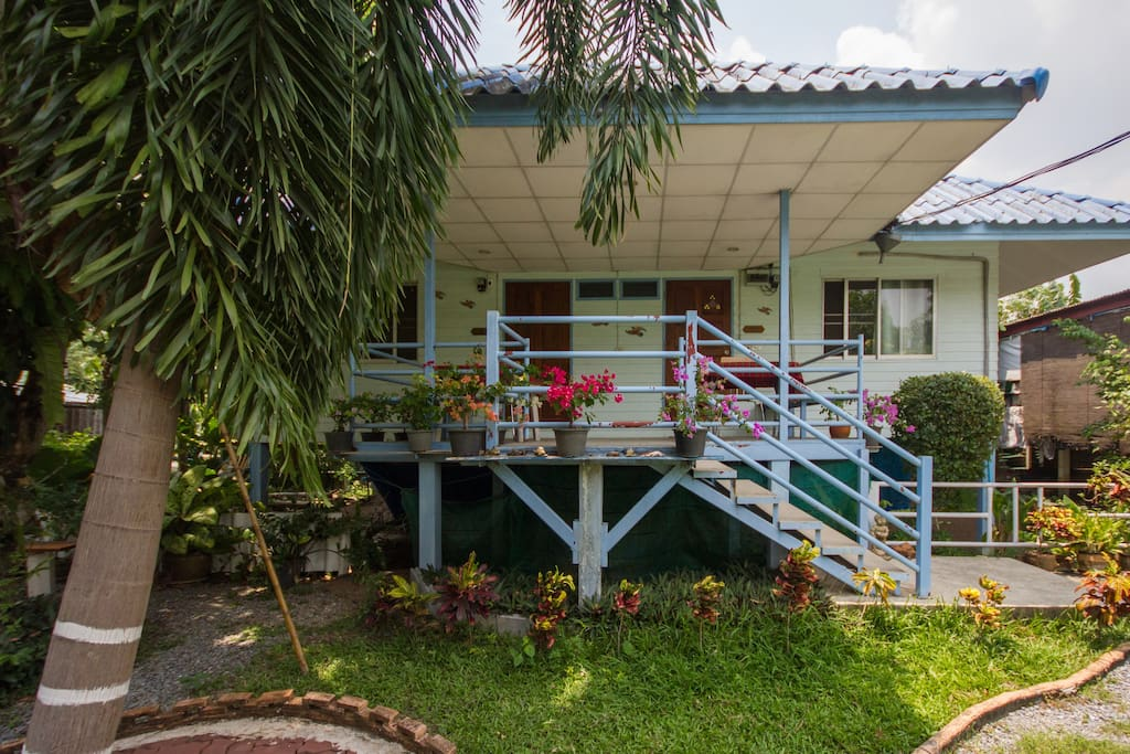 Exterior of your accommodation-set in lush gardens.