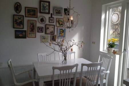 Nice apartment in quiet neighborhood in the capital area. With one bedroom which contains one double bed and bunk bed for the children, also possible to sleep in the couch. Private garden and 12 min. walk to the swimming pool.
