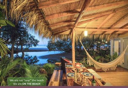 From here all you see is out. You'll find boats to your west, town to the north, beach to the south, and forest to the east. You are walking distance from everything in Tamarindo: the grocery store, the Saturday farmer's market, and so much more...