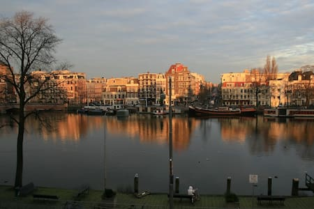Apartment overlooking Amstel river