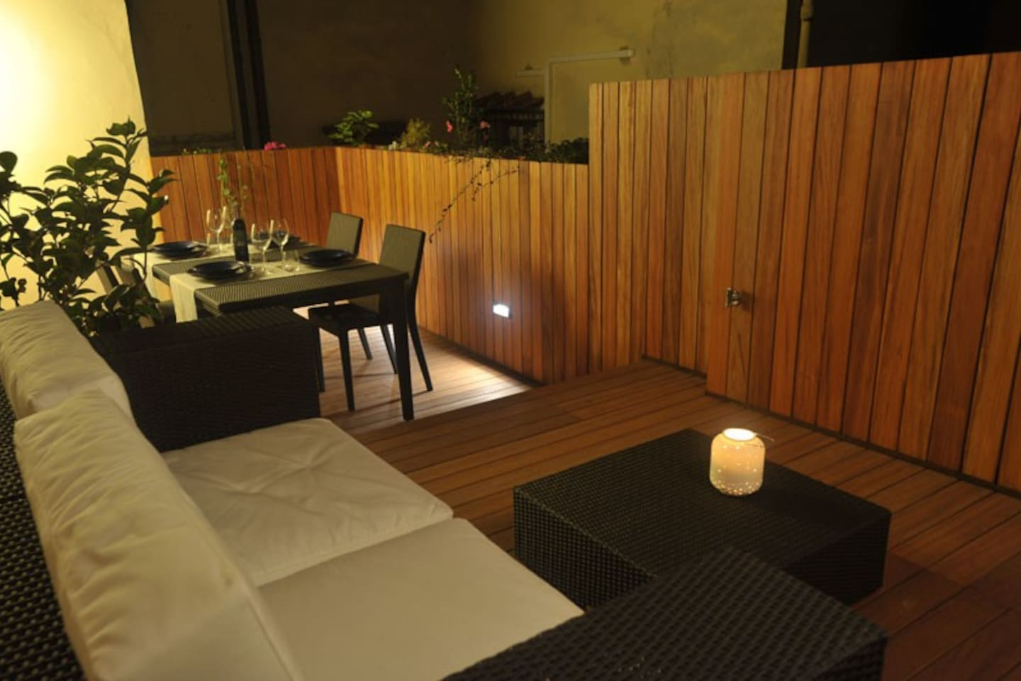 Night view of terrace : high lamp, three LED lights and a fixed wall ligth.