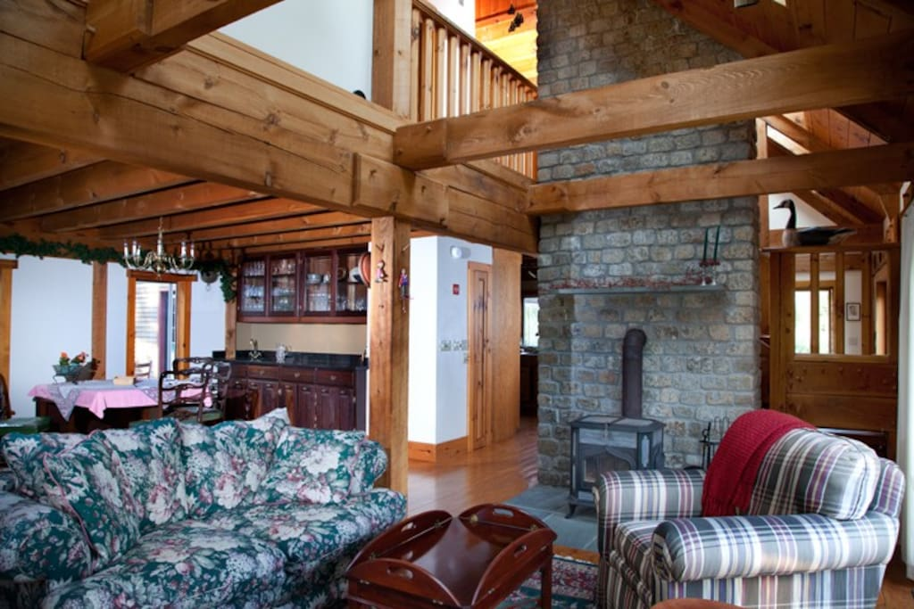 The living room offers many vistas both outside and in as only an open post and beam structure can.