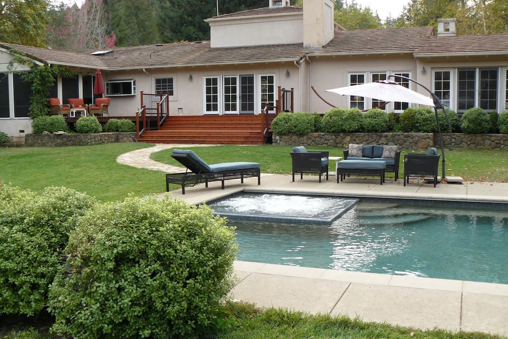 Seating around pool with jacuzzi jets running.  New wide staircase allows easy to pool area.