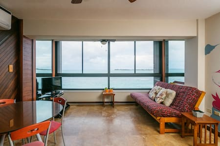 Comfortable, beautifully decorated one bedroom surrounded by two of the most beautiful beaches in San Juan.  This apartment is ON the water; no side views or views from afar.  The beach IS there!  The view is breathtaking.