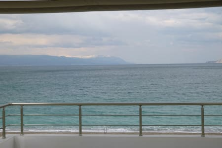 Welcome to a new beach apartment with balcony and view to sea.  The apartment is at the 1st floor and you can view the sea and mountain from the balcony.