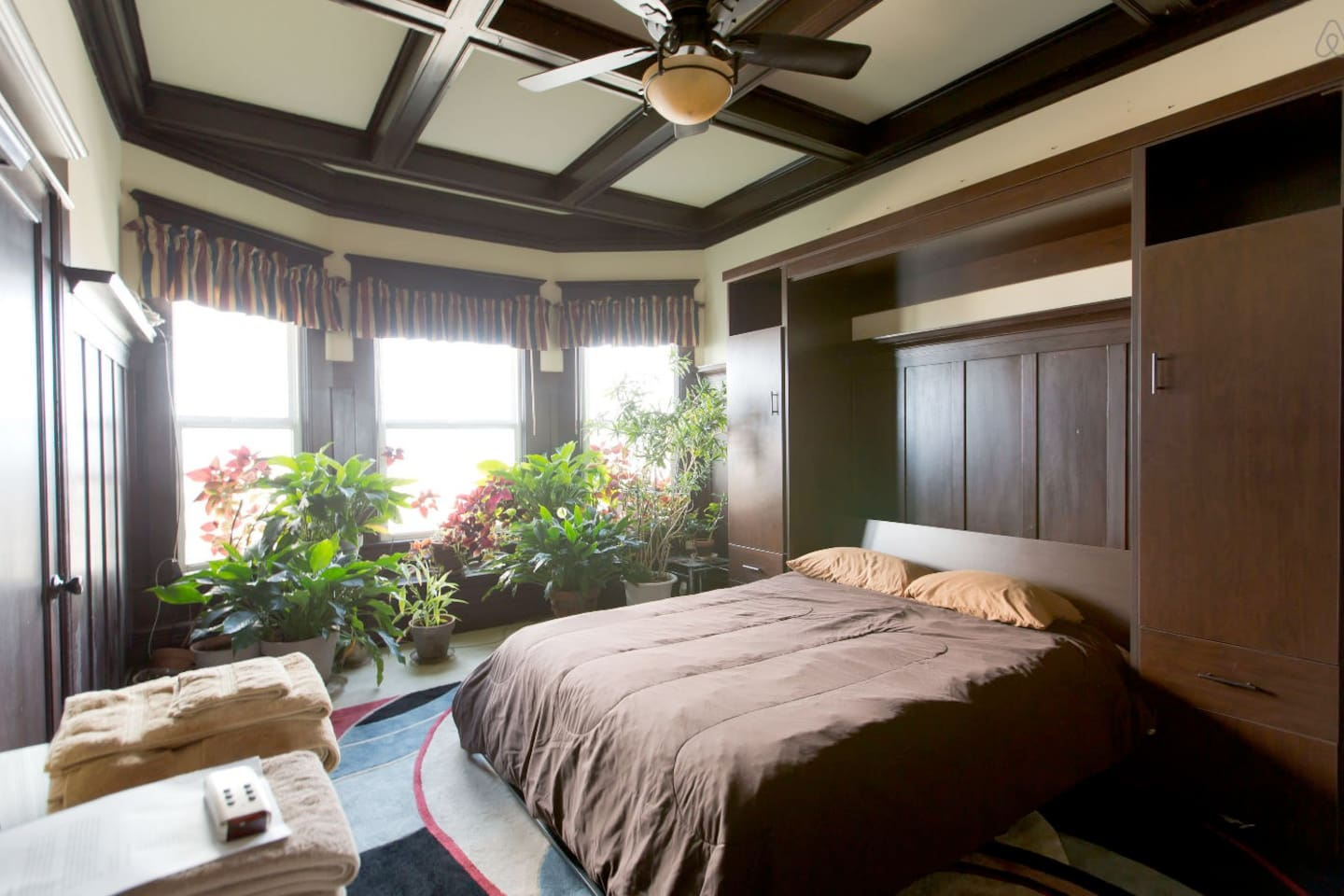 Master bedroom with lush foliage and an awesome view.