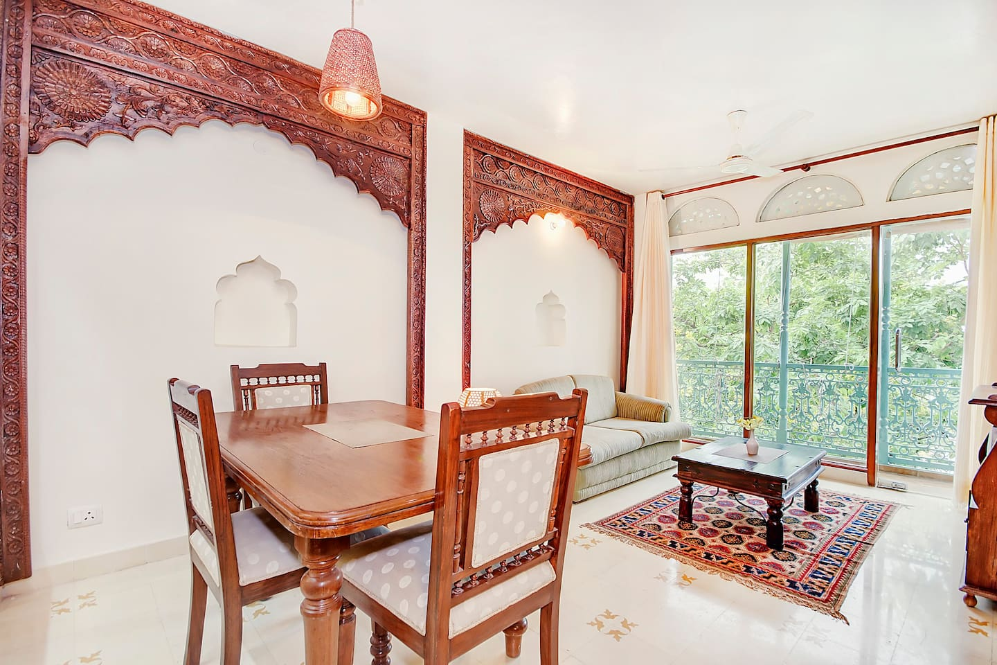 Living cum Dining Room, Overlooking Hauz Khas Pond and 13th Century Monument. Mehrab (Wooden Arches) are old pieces restored from Rajasthan Havelis.