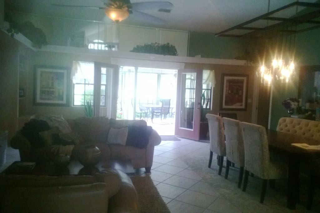 Main living area with dinning table, french doors out to pool/patio.