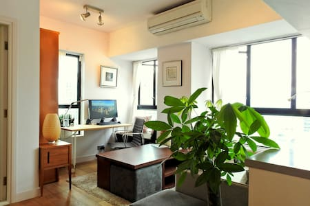 Fully-furnished custom-renovated studio with windows on three sides (lots of rare light & air) and private rooftop with spectacular views — the Peak, HK harbor / skyline, Kowloon hills — all just steps from HK (PoHo's) hippest cafes, bars, galleries.