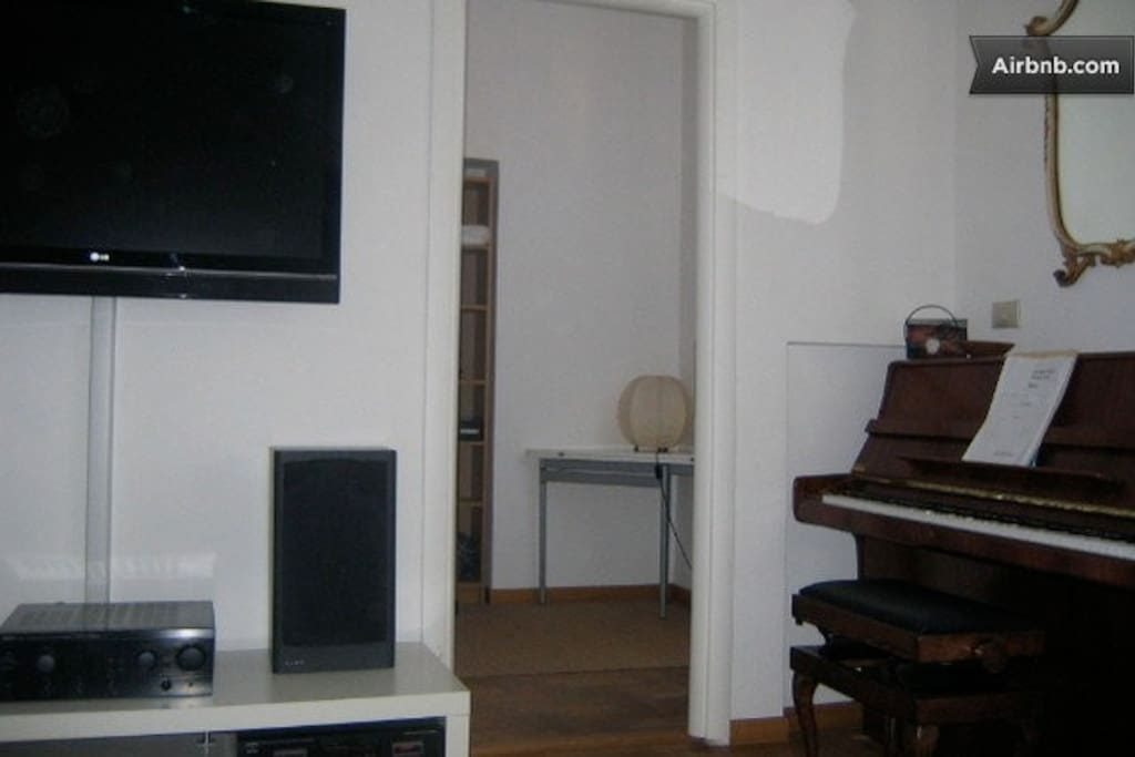 LIVING ROOM AND FULLY TUNED FEURICH PIANO