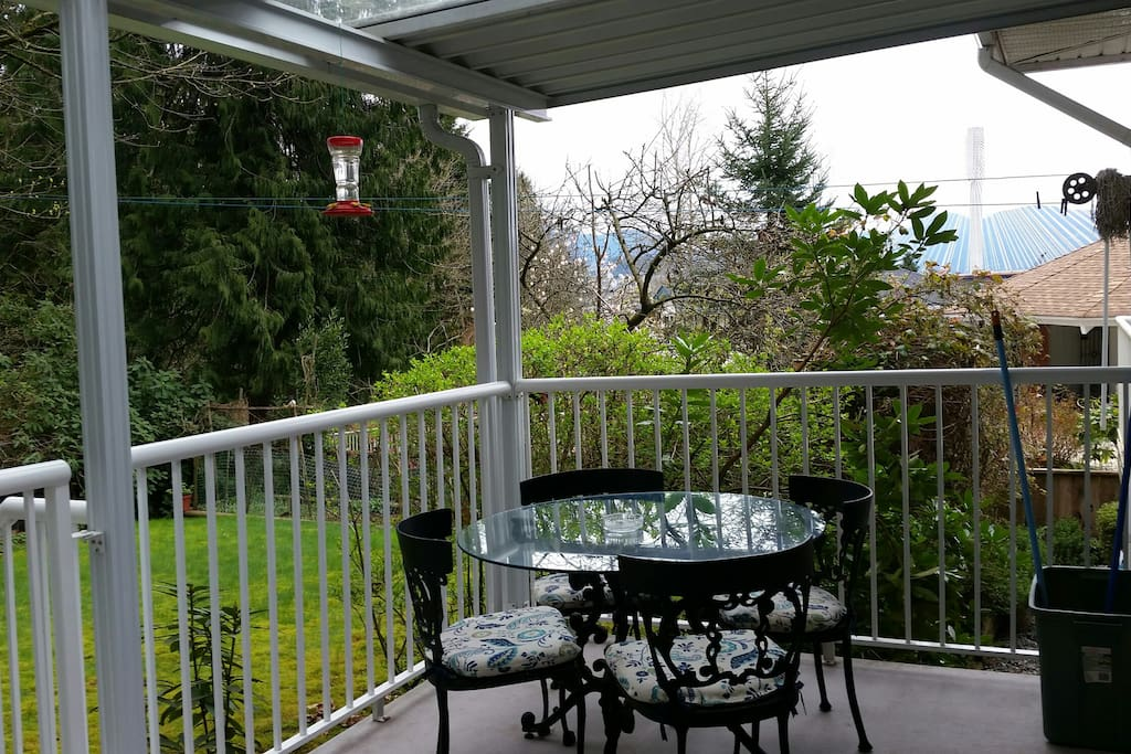 Patio set on private covered deck overlooking back yard