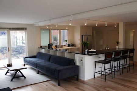 Modern Apartment Overlooking Brook