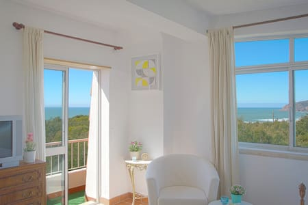Enjoy a unique holiday in a unique space ! Just 10 minutes walk from the beach and 30 km from Lisbon (A5 ) . With everything you need .. garden, swimming pool , play areas and a terrace with a view of the Sintra hills and the Guincho beach.