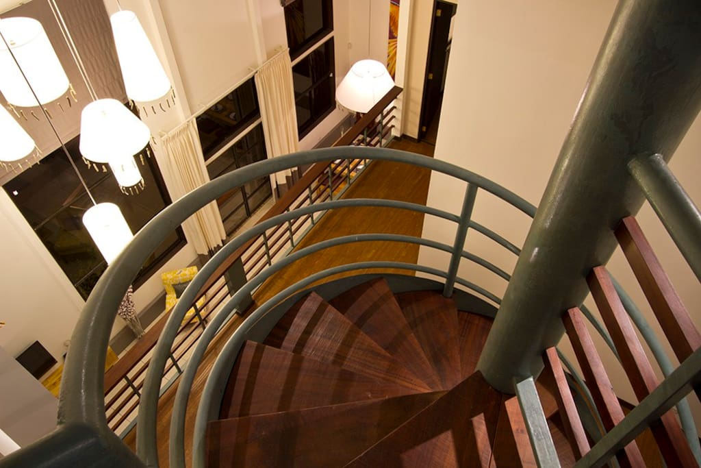 Looking down spiral staircase from third level
