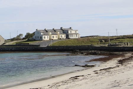 Set near the Bunowen Pier with a white sandy beach directly across from the property.