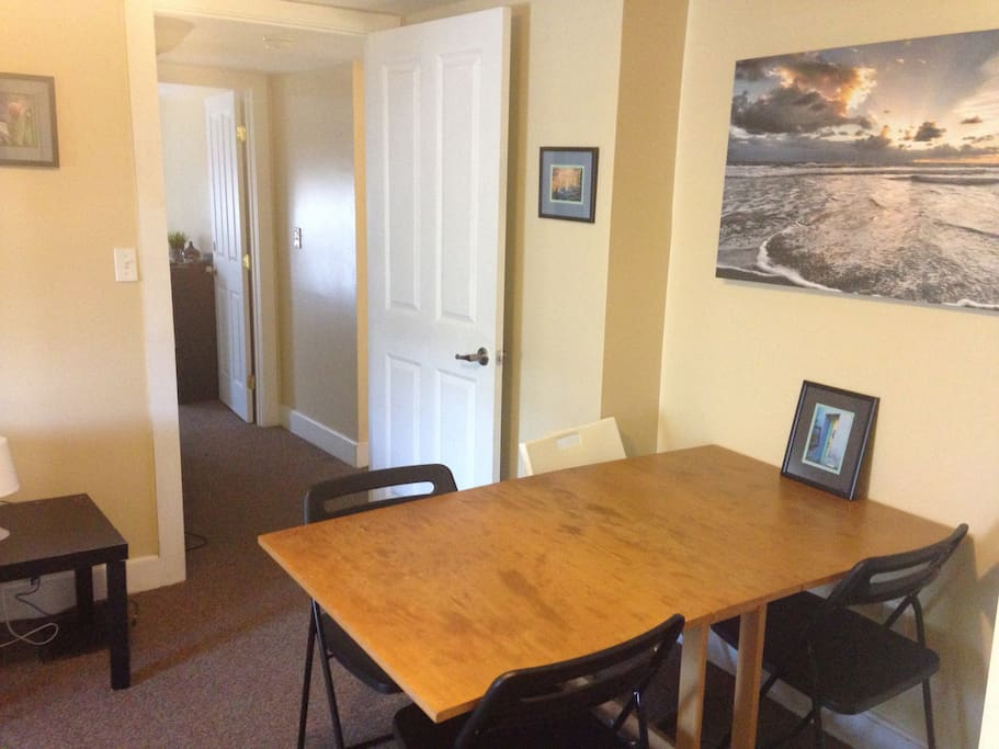 dining table that sits four in living room.