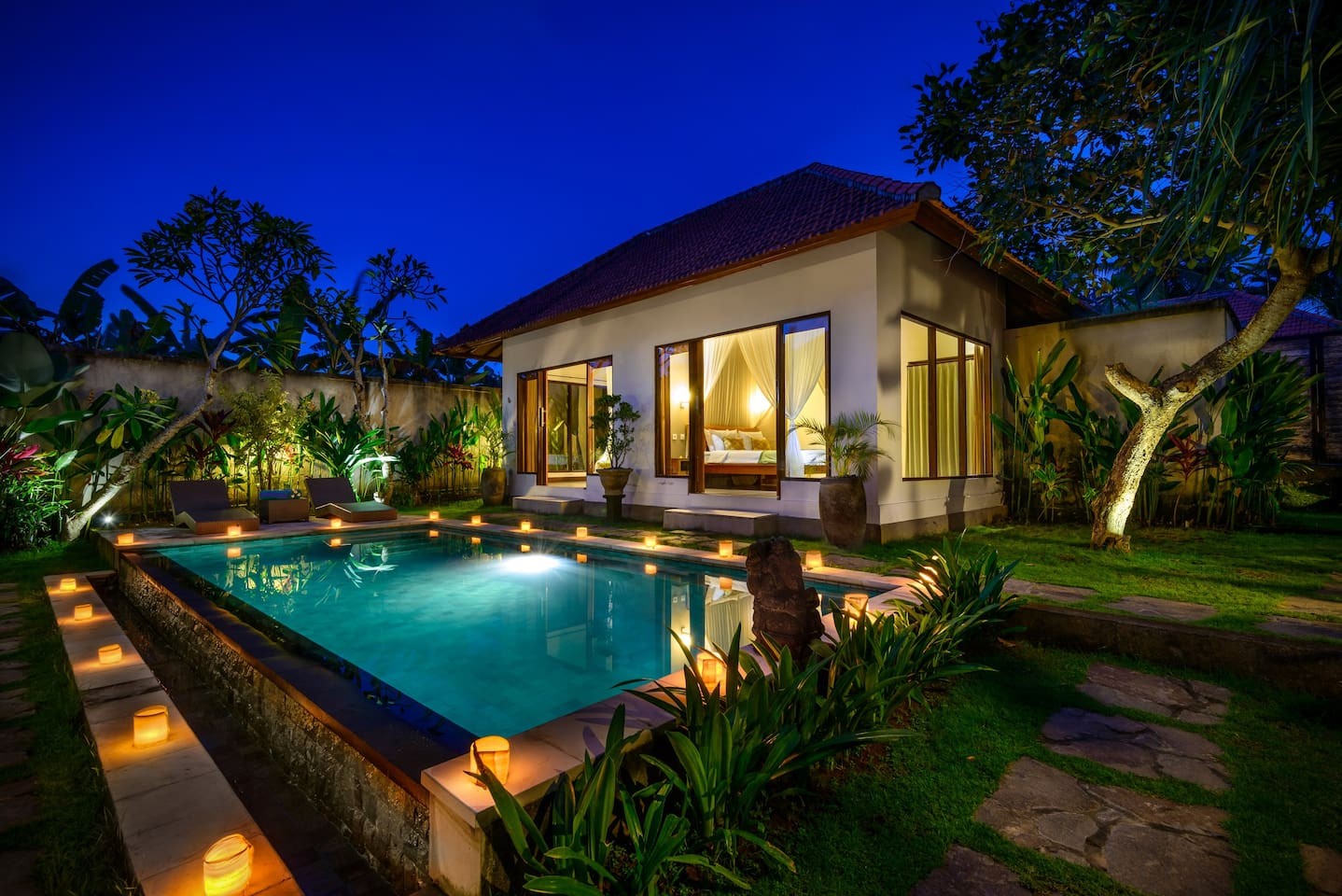 Swimming pool and bedroom by night