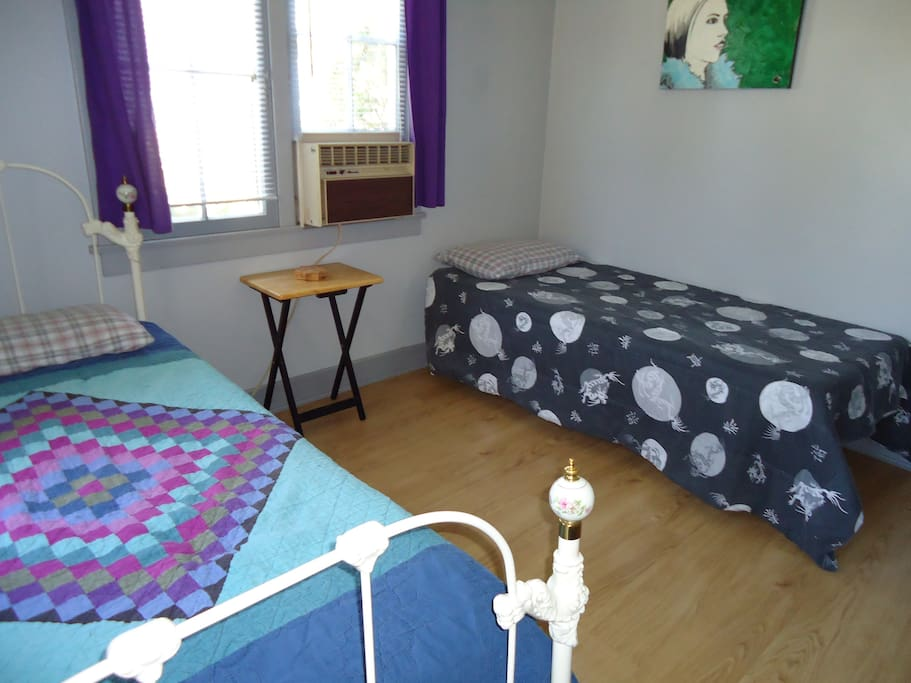Here, the room is pictured with the two twin sized beds option.  The tray table has been replaced by the small dresser.