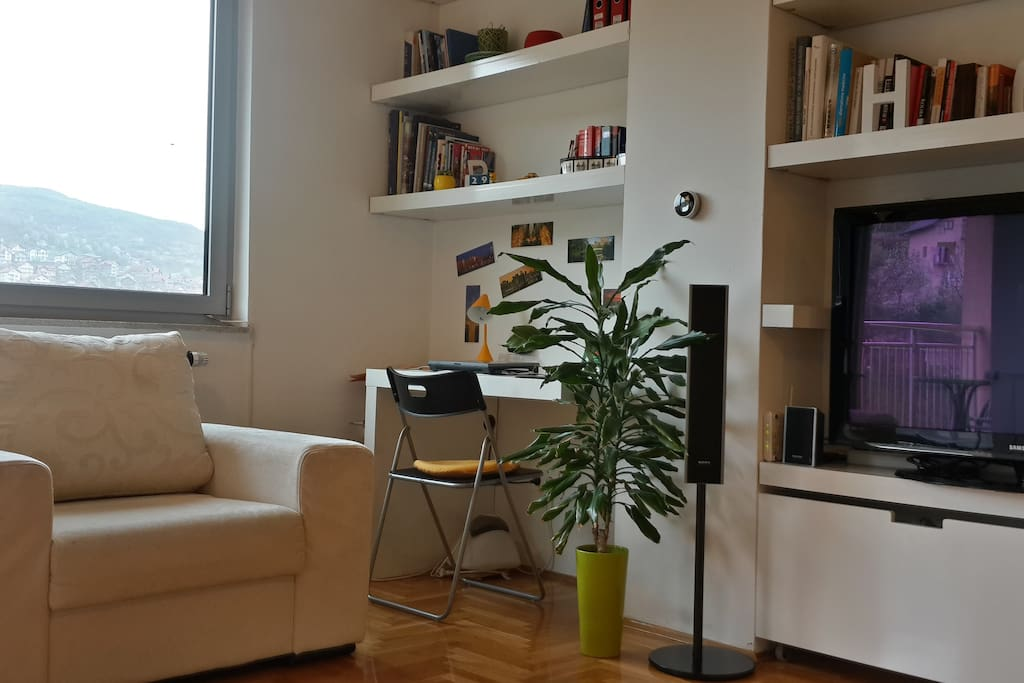 Living room - with 42'' Samsung TV, Sony home entertainment system and workdesk with HP laptop and printer