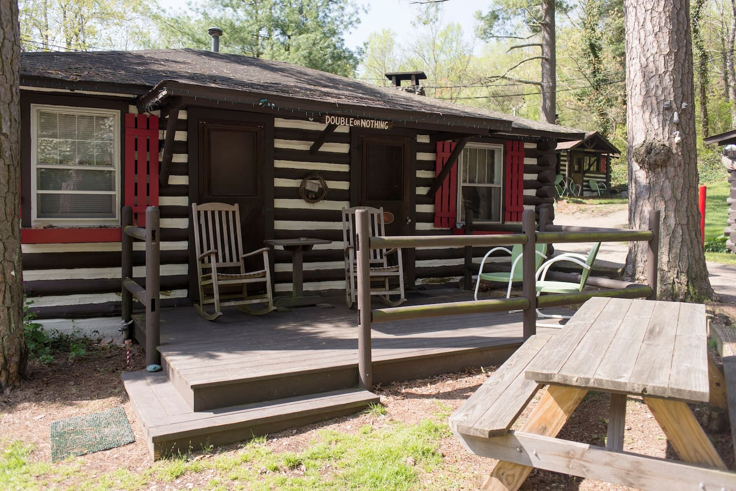 Double or Nothing cabin with rocking chair front porch and picnic table