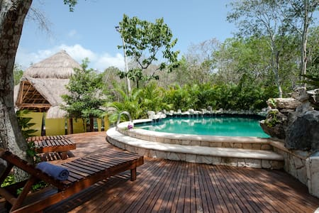 Introducing Chemuyil Club y Villas, a luxury jungle hideaway between Playa del Carmen and Tulum with all the comfort and peace. 5 mn by car to Xcacel Beach as well! Enjoy this luxury 4 Bedroom Villa with private terrace.