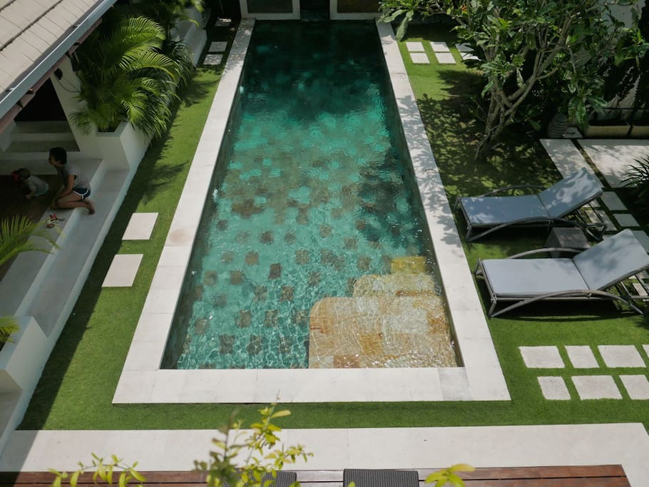 View over the large pool and garden from 1st floor balcony