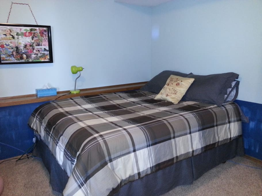 Comfortable queen-size bed in a spacious room. Quiet space all your own.