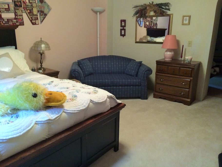 A couch in the room provides a seating area for your comfort and relaxation.