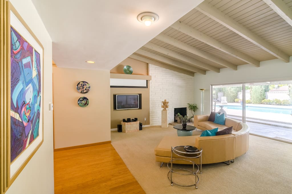 The living room overlooks the pool area.