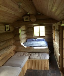 This is a traditional log cabin with views of the Pennines, Cairn beck flows yards away and lots of wildlife. Very basic with a large double bed, room for one more at a push. Camping loo.  Pots, pans, plates and gas hob. Electricity if needed. Wood burning stove.