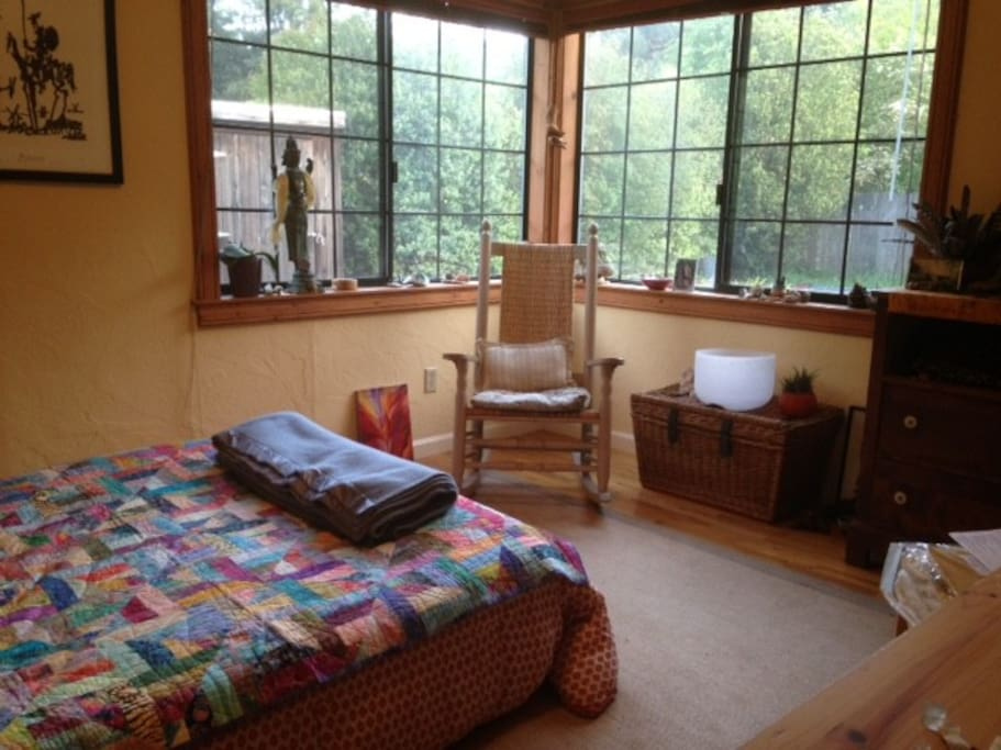 The room looks out to the garden and trees ( and the pool).