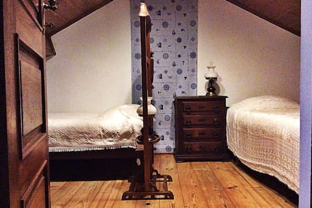 This charming wooden room in the attic will make feel like in a boat cabin. You have your private chest to range your clothes, shared external bathroom with shower as well as acces to our kitchen, living, dining room and beautiful veranda.