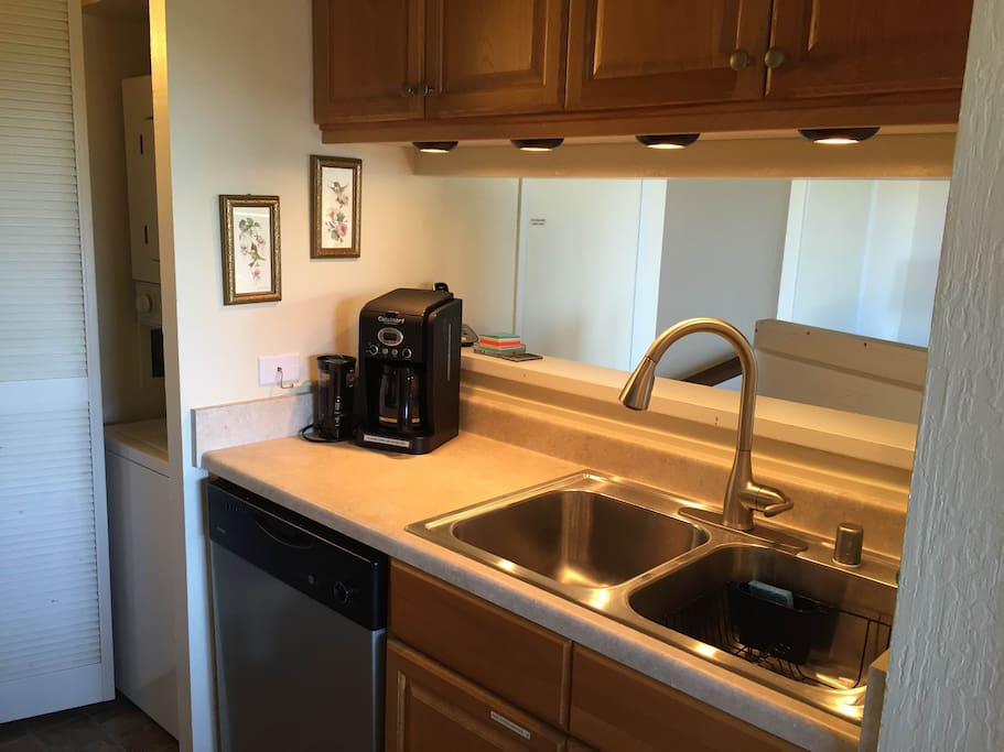 Kitchen has new countertops and sink. Dishwasher & washer/dryer