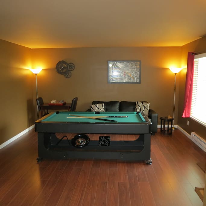Multi-function pool table with roulette wheel, and craps table.