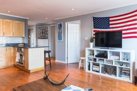 A beautifully updated apartment in the coolest neighborhood in Manhattan. The elevator opens into living room of the large apartment, which includes wood floors, rooftop deck, laundry in unit, great sunlight, TV in bedroom, and new kitchen.