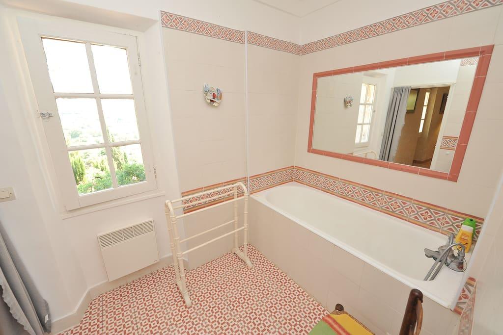 Bathroom adjacent to first bedroom bedroom