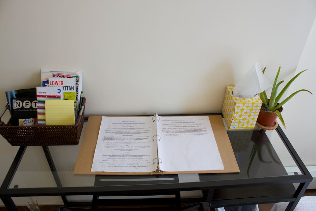 Desk with house manual, recommendations, and maps/guidebooks.
